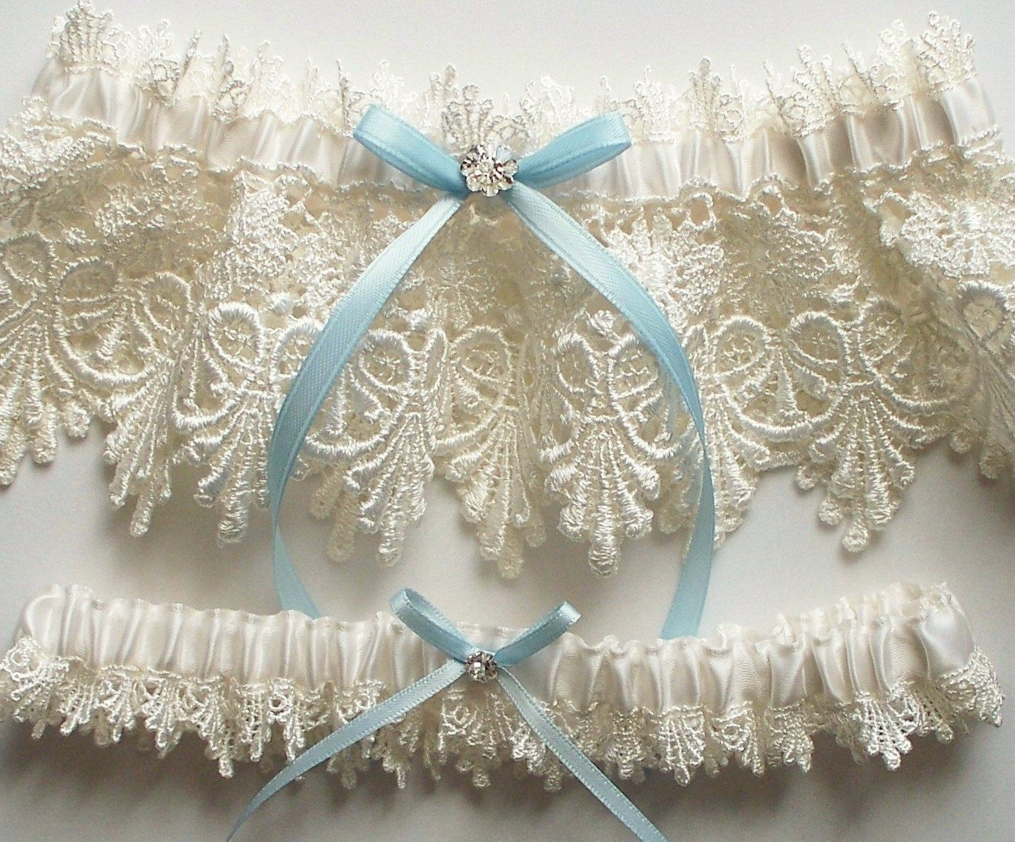 Lace Garter Wedding Set With Blue Satin Ribbon Bow And Swarovski Crystal Centering The Alicia