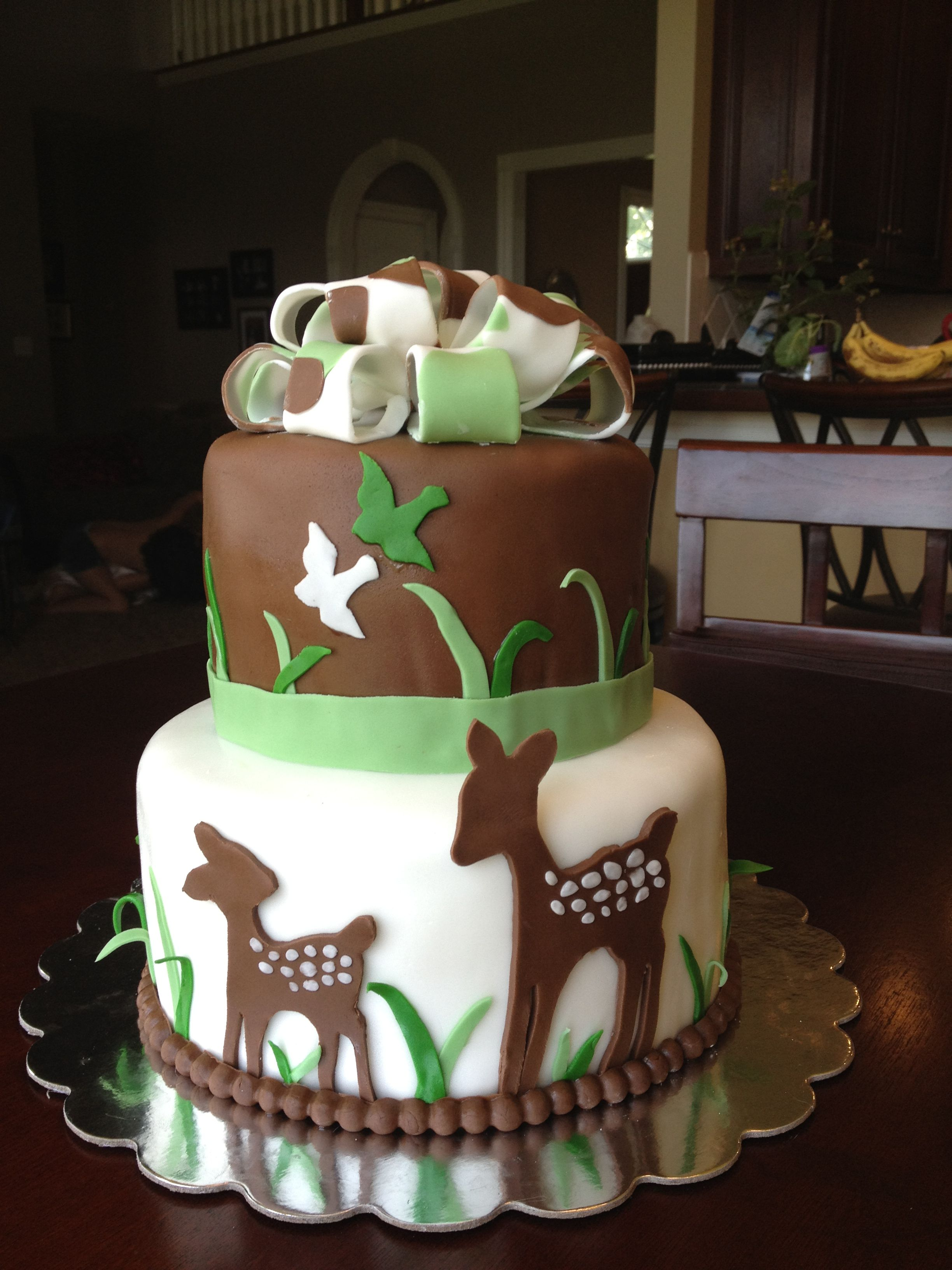 Deer cake Green white brown fondant with deers and camo bow