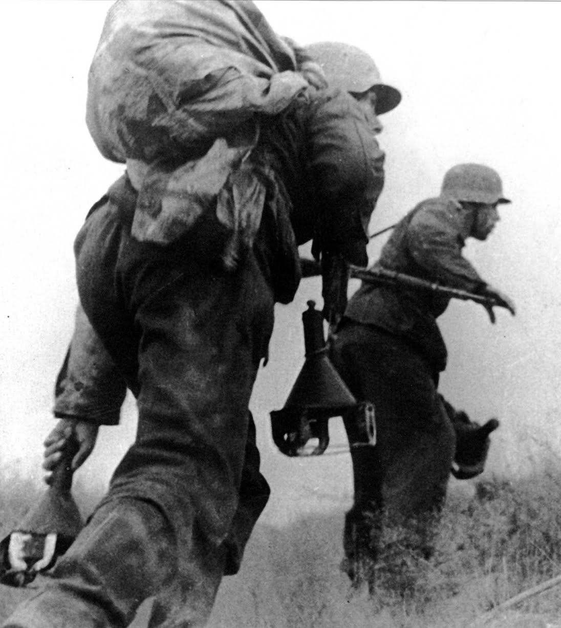 A pair of Waffen SS soldiers armed with limpet mines.