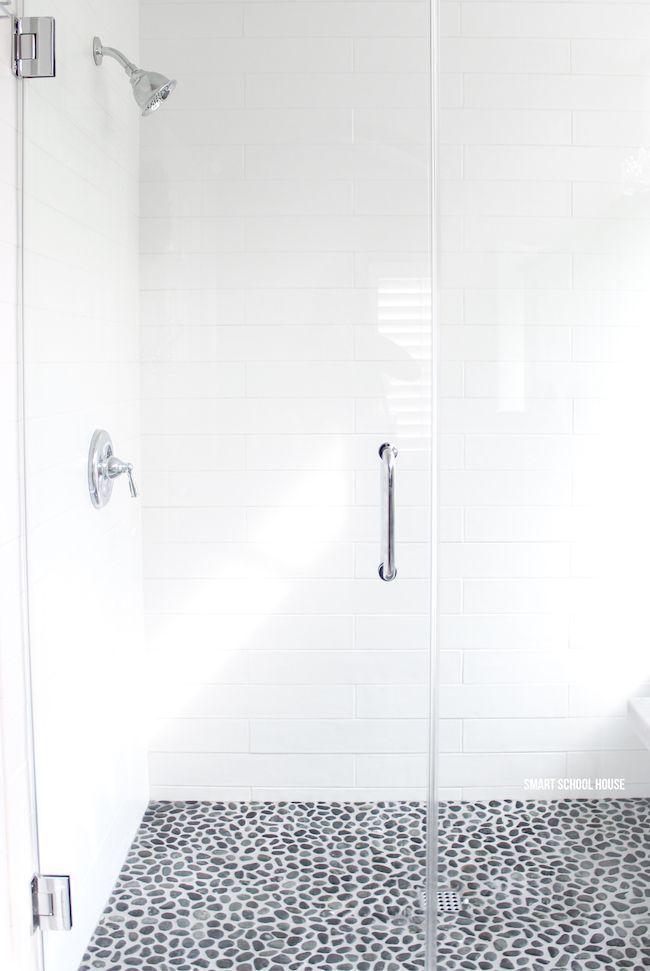 Gray And White Bathroom Ideas Long White Subway Tiles Large Glass Shower Doors Chrome Fixtures S Gray And White Bathroom White Bathroom Pebble Shower Floor