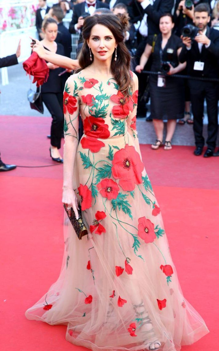 Frederique Bel wears a nude gown covered in poppies by Russian ...
