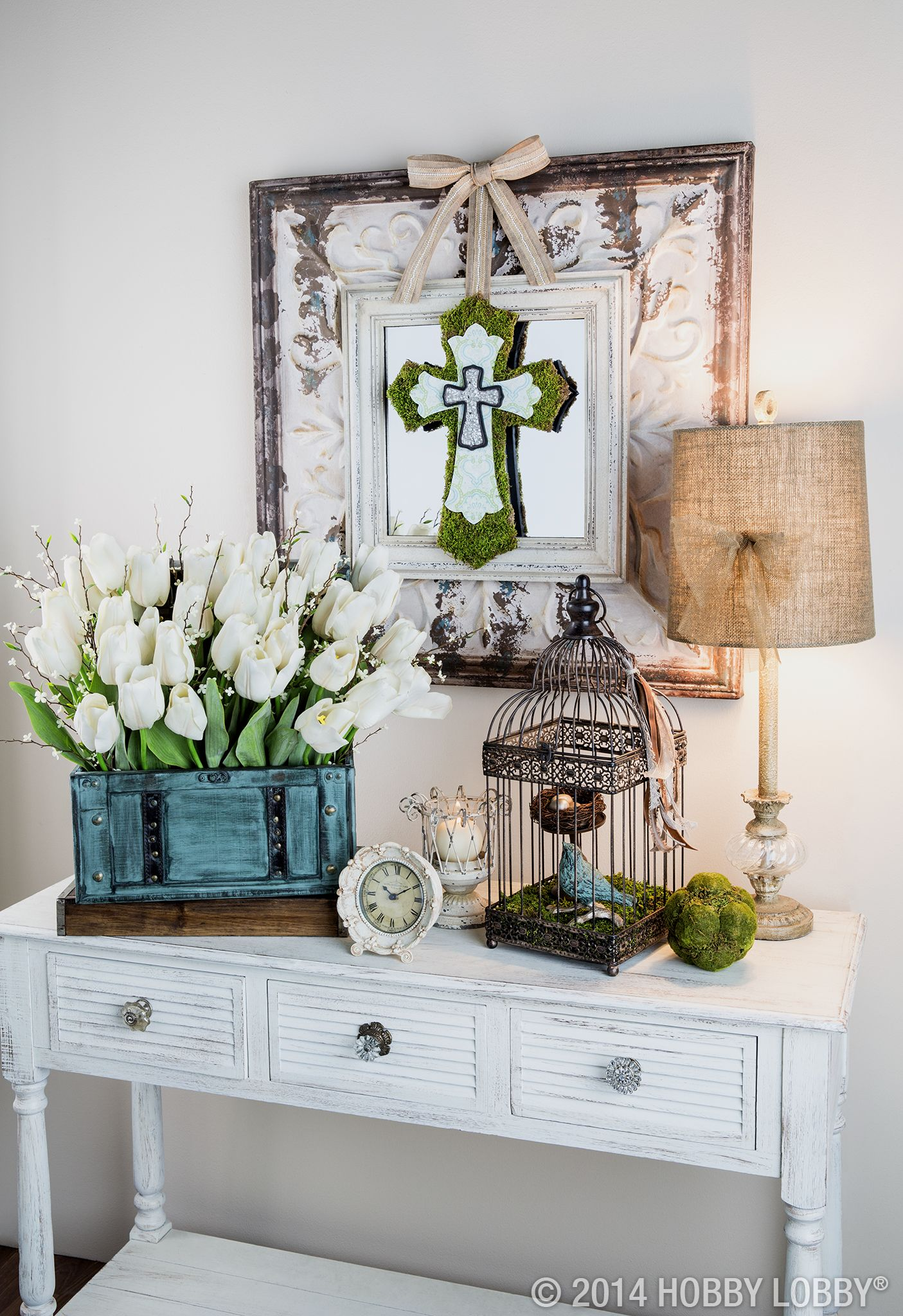 Create a warm and inviting entryway to wel e guests for Easter