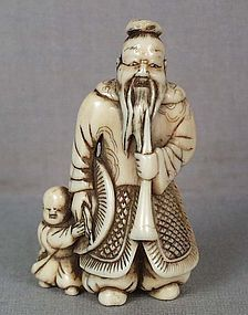 18c netsuke MONGOL WARRIOR with child & trumpet