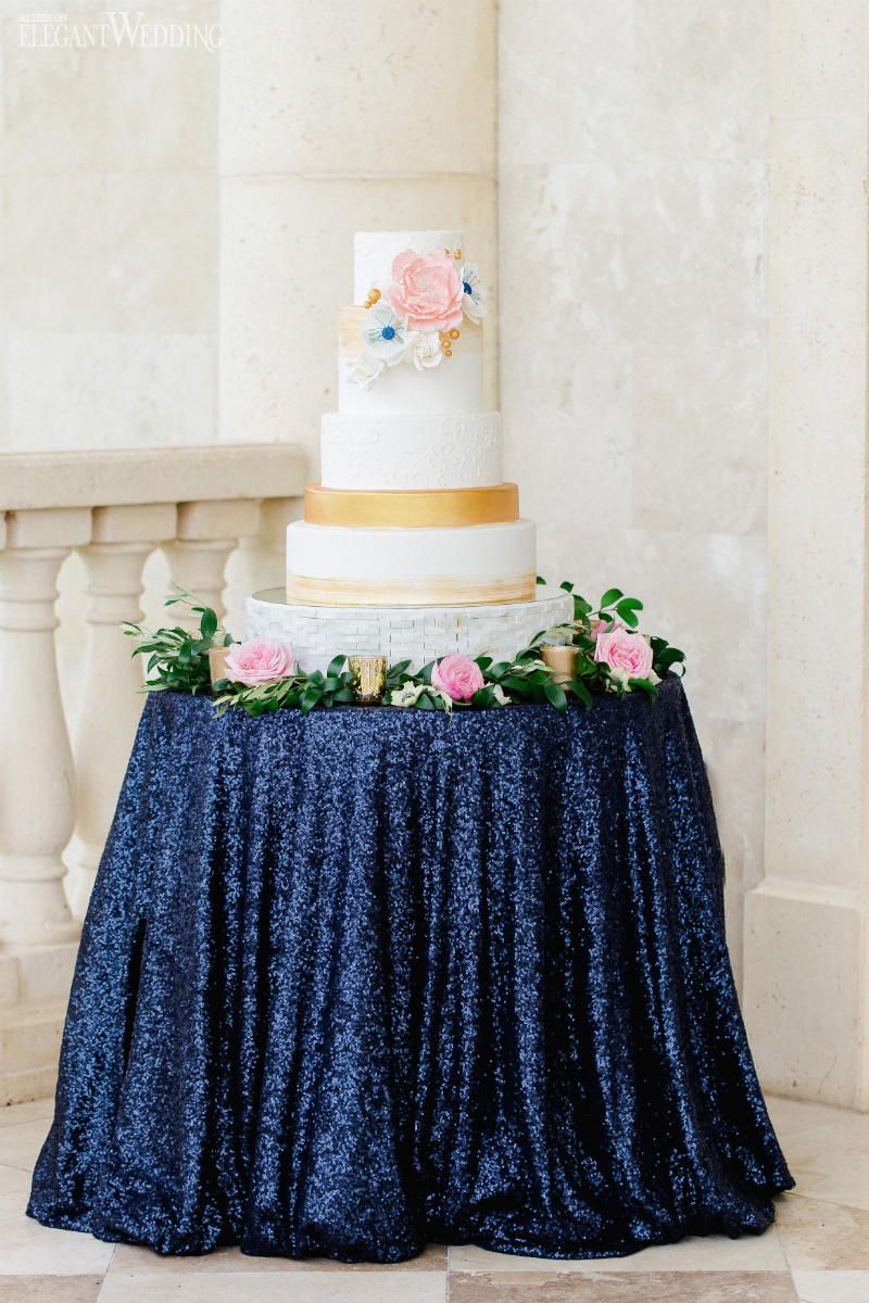 White and gold wedding cake blue sequins linens royal blush
