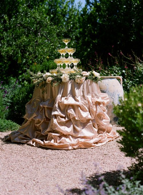 Wedding - Blush ruffled table cloth for a champagne tower