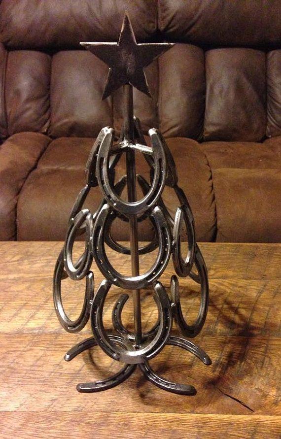 Best 25 horseshoe christmas tree ideas on pinterest for Christmas tree made out of horseshoes