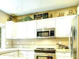 Image result for pan clocks on above your kitchen cabinets ...