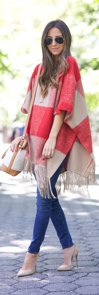 This cute red and beige gingham blanket coat goes a treat with skinny denim jeans and pale heels. Via Arielle Nachami.