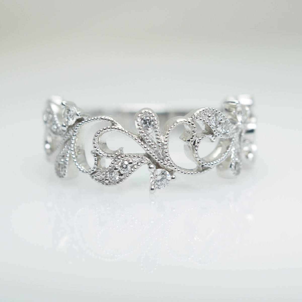 It is an image of Intricate Diamond Flower Style Wedding Band in 50k White Gold