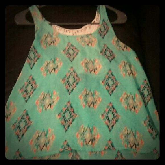 Cute flowy top Cute teal flowy top with tribal print. Crochet ivory detail in back. Tops Blouses