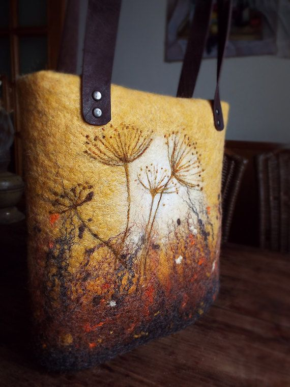 "This bag is hand made using wet felting technique that creates a ""watercolor"" effect. Picturies are on both sides of the bag Handles are made of natural leather The bag is lined with fabric. Top zip closur."