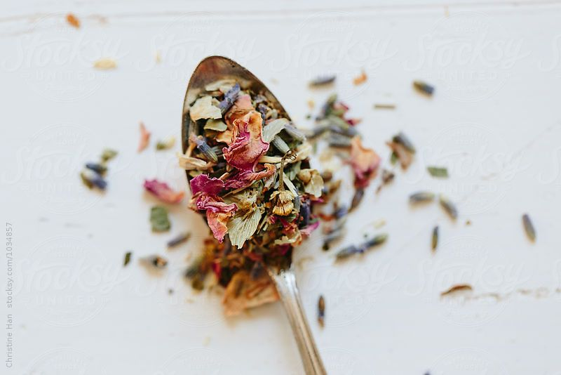 close up of a spoonful of tea by Christine Han for Stocksy United