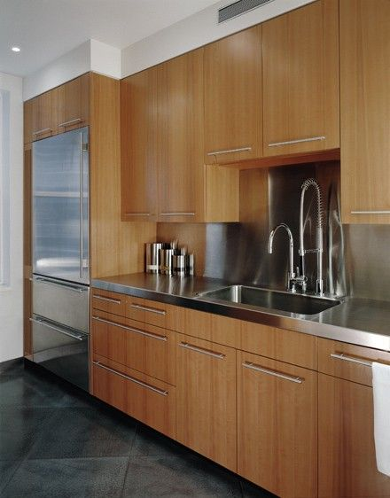 Stainless Steel Counter Top Backsplash With Bamboo Cabinet Doors