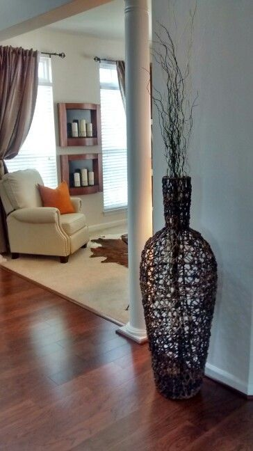 large wicker floor vase with branches