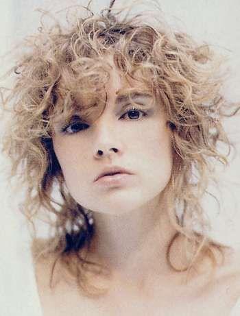 edgy frizzy curly shag hair