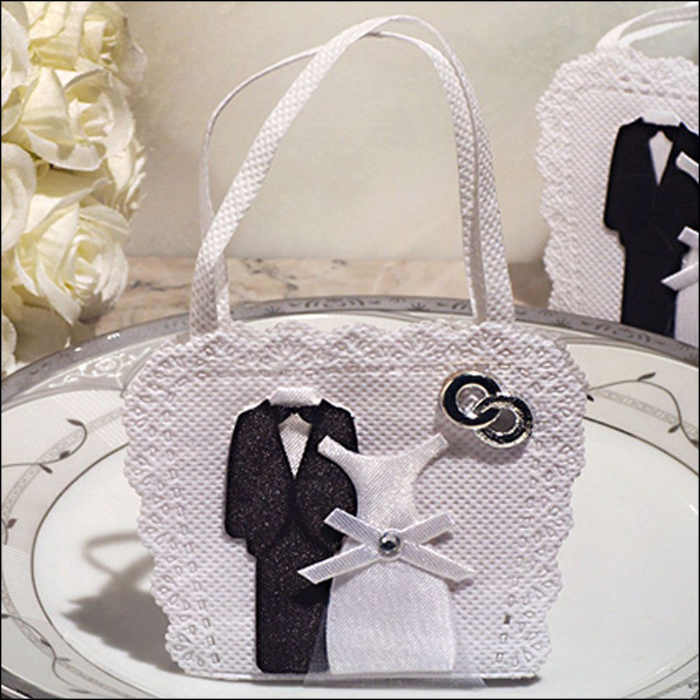 Pretty white woven fabric wedding favour bags with bride and groom ...