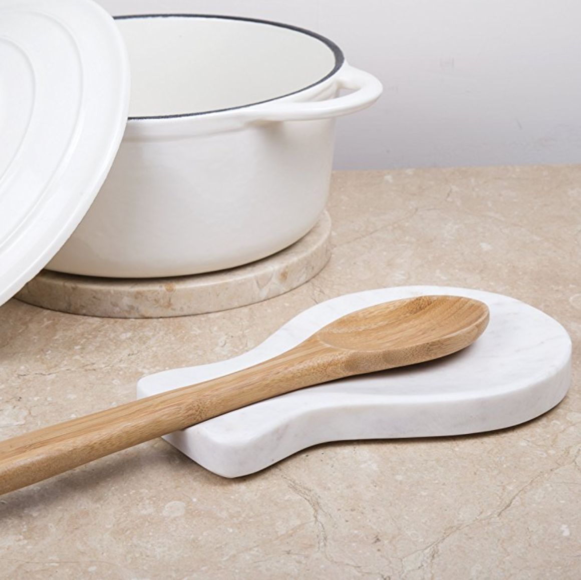 White Natural Marble Spoon Rest  Spoon Rest are made of natural marble stone, it does not absorb any moisture ,odors or fats from food or soup. As marble stone is valued for its contrasting veins of color which can add aesthetics on your kitchen counter top.
