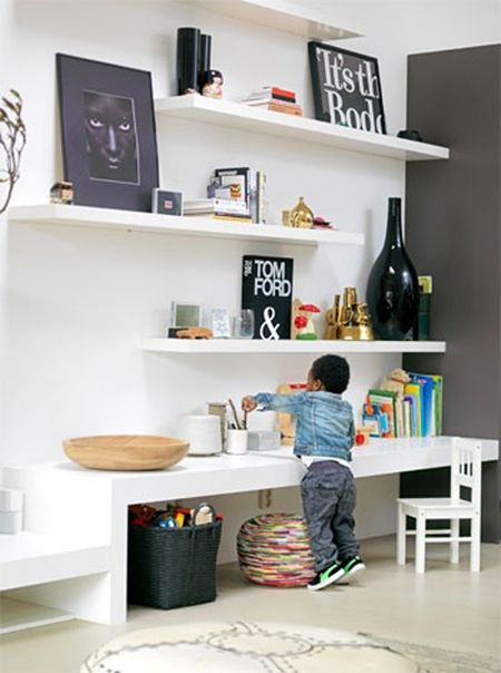Shelving unit with grown up accessories while down below is an area for the kiddos via House and Home