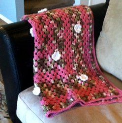 This gorgeous Flower Shell Blanket is an #easycrochetedafghan that's perfect for spring. The flowers can be made in whatever colors you desire, or they can be left off altogether. Follow a simple crochet shell type pattern to complete this project.