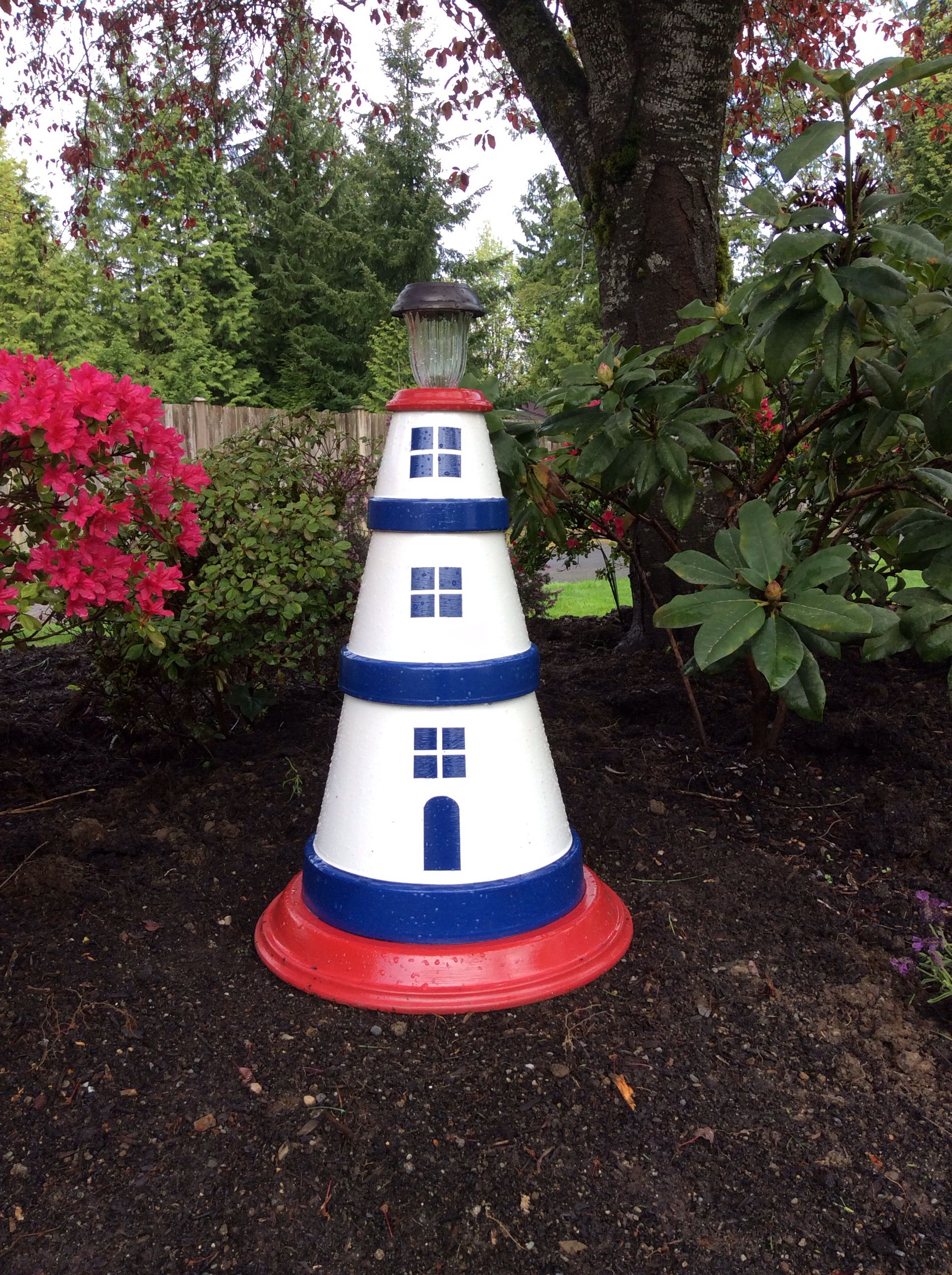 Diy terracotta lighthouse for the garden made this one