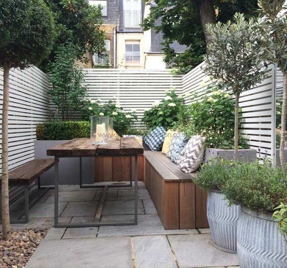 15 Tiny Outdoor Garden Ideas For The Urban Dweller: Contemporary-table-benches-garden-design-London