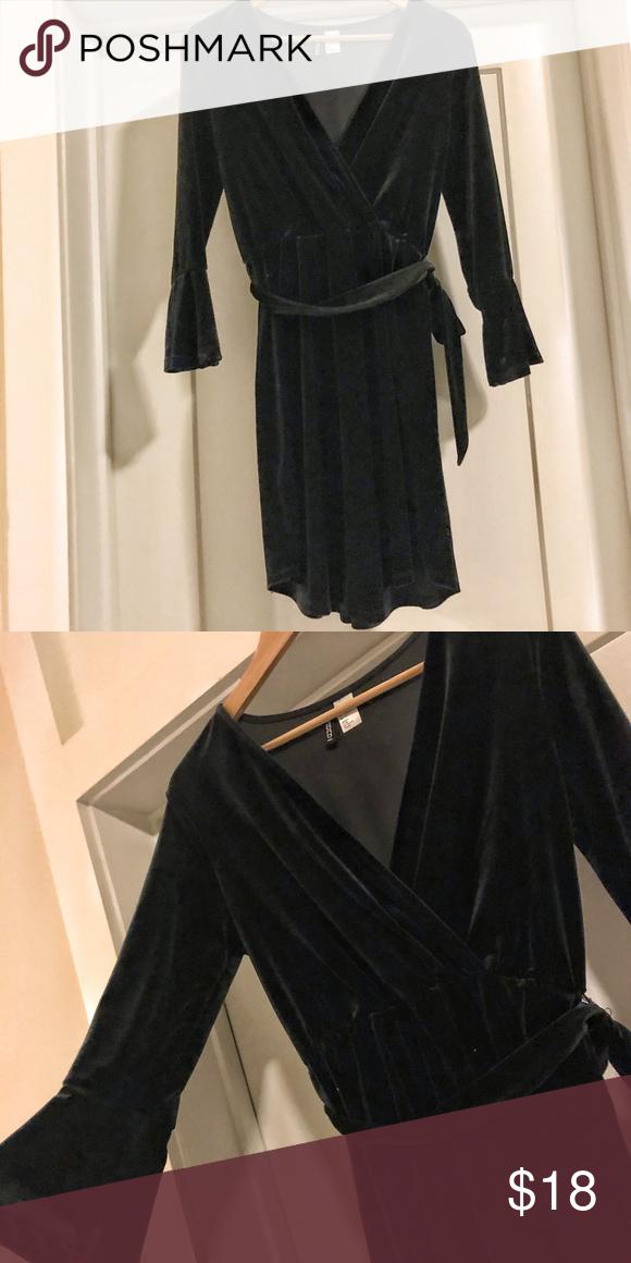 229a6f638302b H&M black velvet wrap dress Black faux wrap, velvet look dress with bell  sleeves H&M