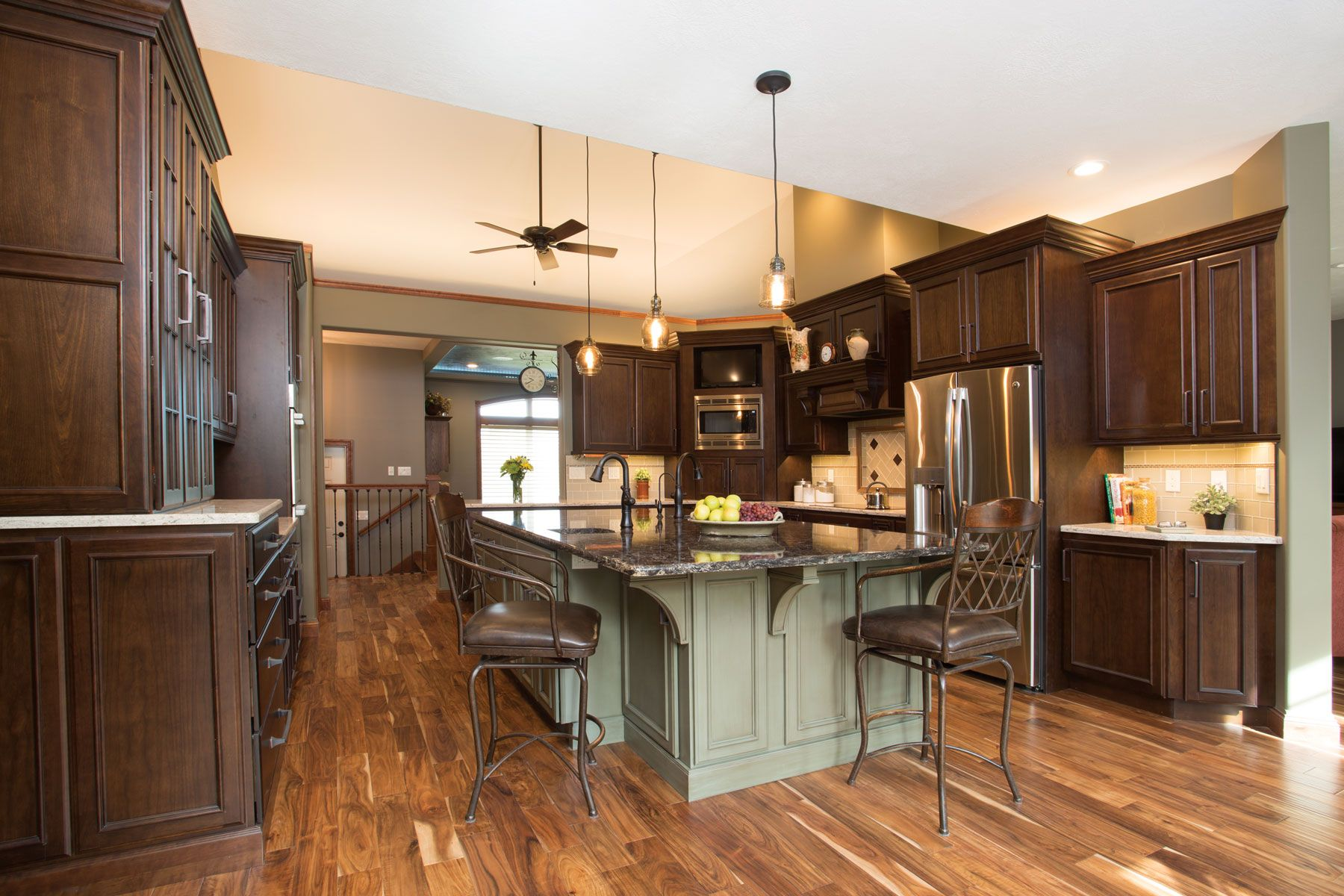Starmark Cabinetry S Harbor Door Style In Cherry Finished In Hazelnut Was Used For The Perime Kitchen Decor Modern Modern Kitchen Design Kitchen Cabinets Decor