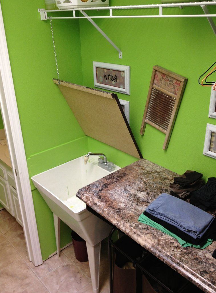 Laundry folding countertop hinges open to reveal utility for Laundry room sink and countertop