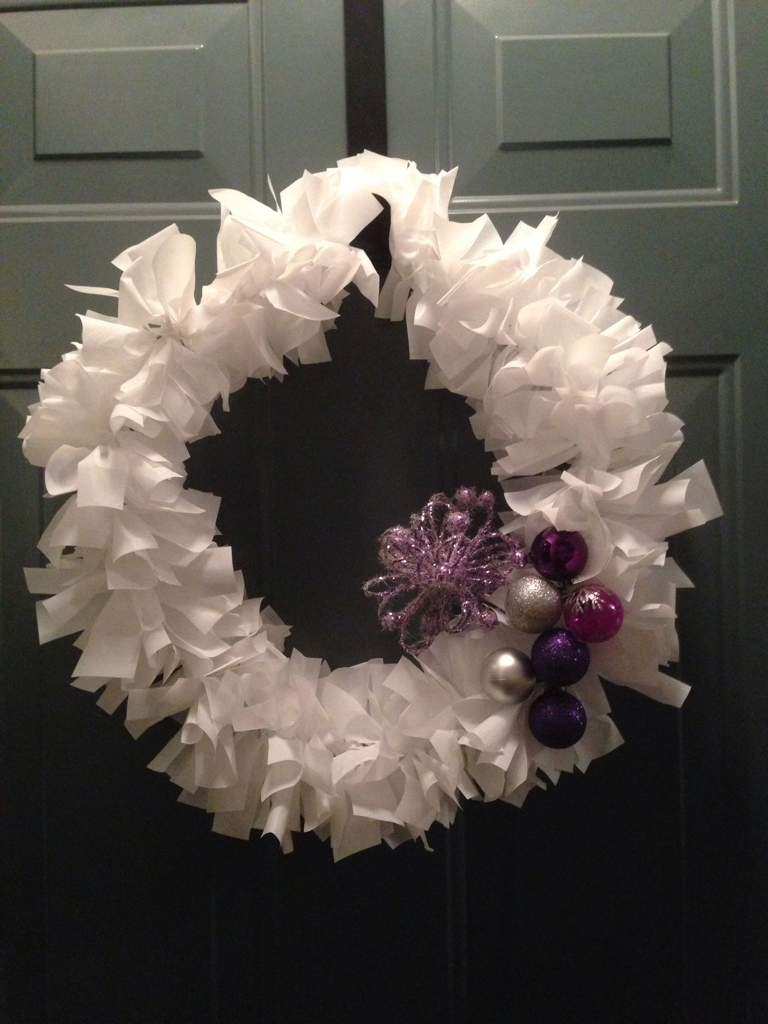 Holiday Wreath, wire hanger, plastic table cloth and some