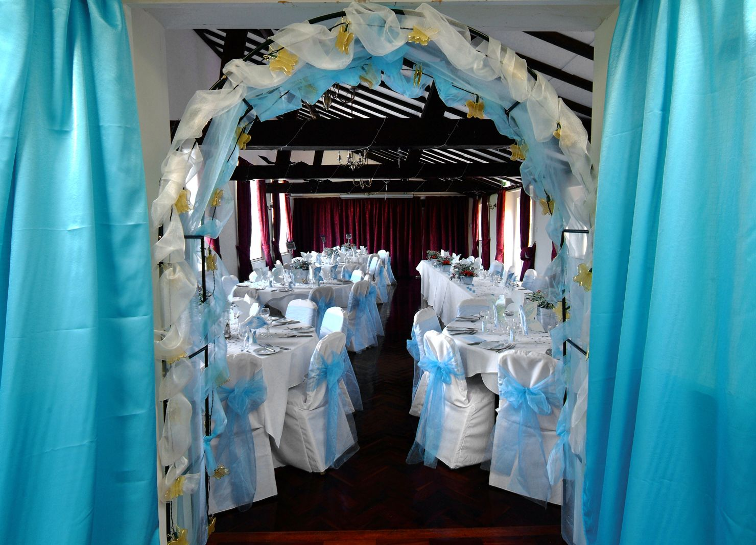 Turquoise Organza Bows on White Chair Covers White chair