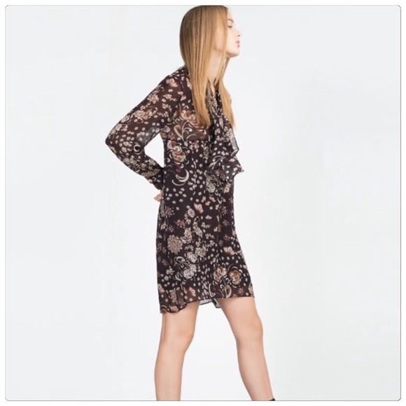 Zara floral drape dress Zara floral semi sheer dress. Top upper part is semi-sheer, but skirt portion is fully lined. Tie at the front. Size XS (fits like a S). Brand new with tags. Very pretty for Spring!  Zara Dresses