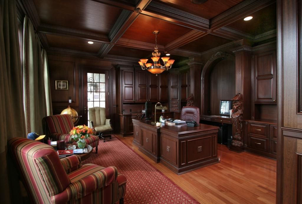 formal office with dark wood paneling and ceiling Homes