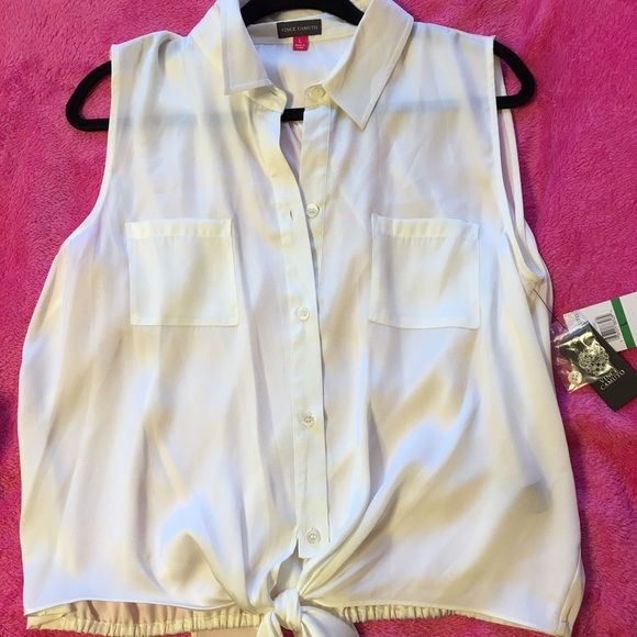 Vince Camuto Top A top that ties at the waist and buttons up the front. It is 100% polyester. This top features two pockets on front of shirt. Vince Camuto Tops Blouses