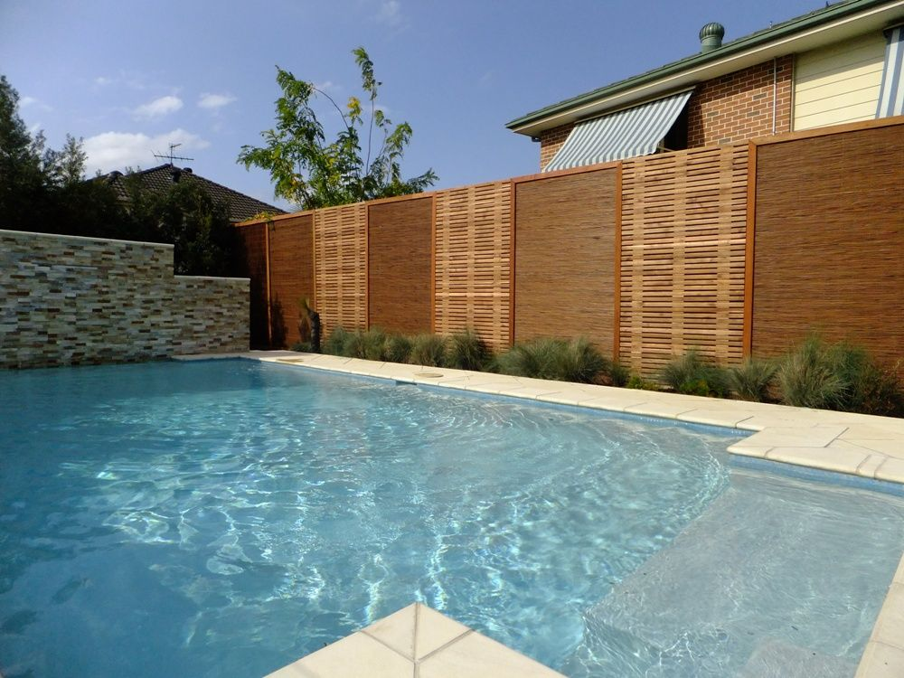 Natureed with featured Acacia timber slat screens Pool