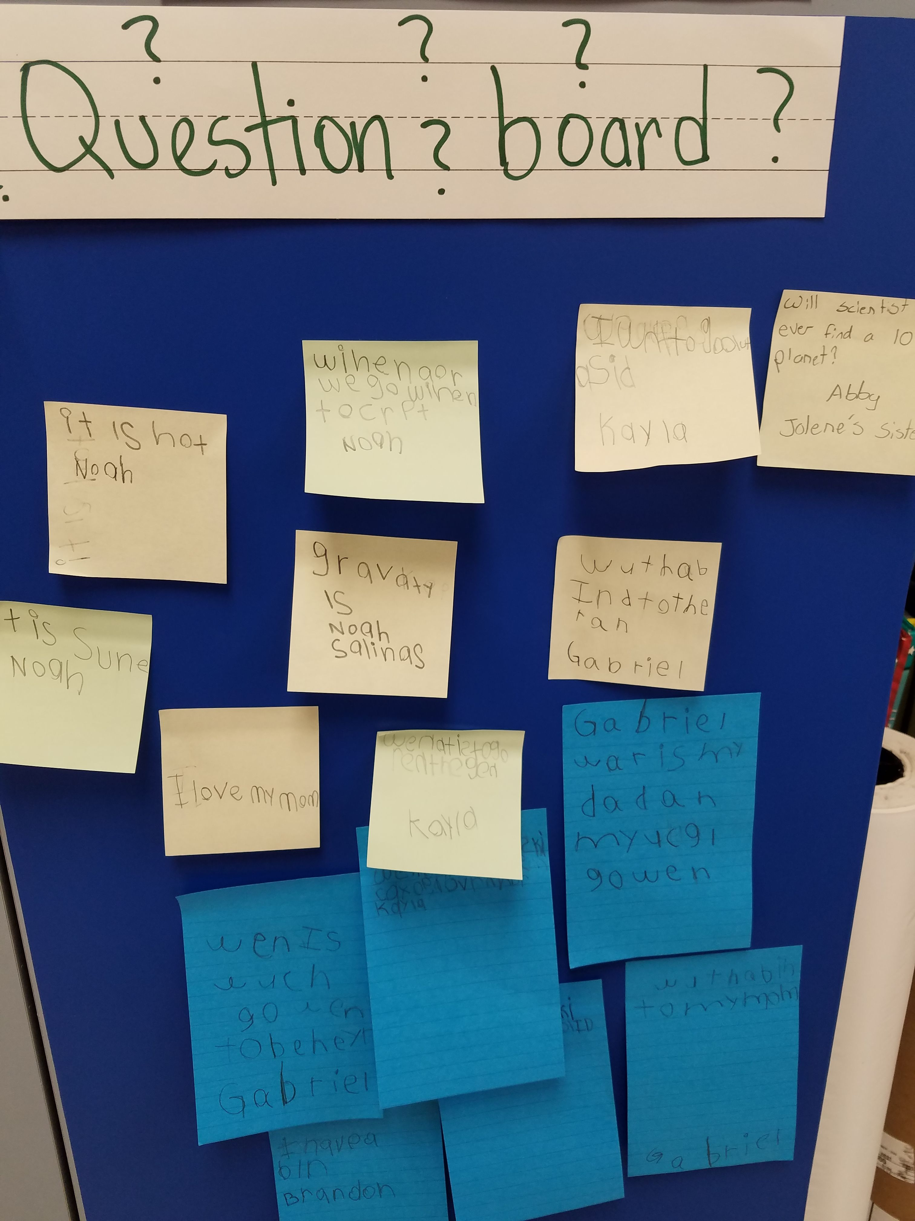 Create a question board to post questions and set up a question box area for children to write questions.