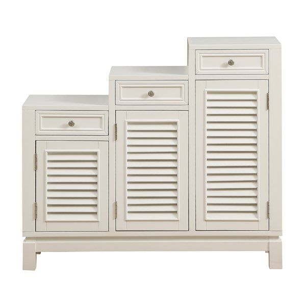 Defined By Its Distinctive Stair Step Silhouette This Charming Credenza Cabinet Gives An Understated Design On Trend Twist Hand Painted A Crisp White