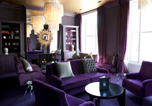Purple Monochromatic color scheme in this royal purple living room