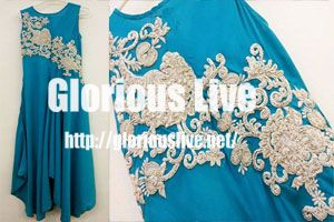 Blue color silk dress silver hand embroidery work on neckline allover shimmering ..Silver and light ivory draped bodice wedding dress ..These days usually plain cloth of chiffon, georgette and silk is used by designers...