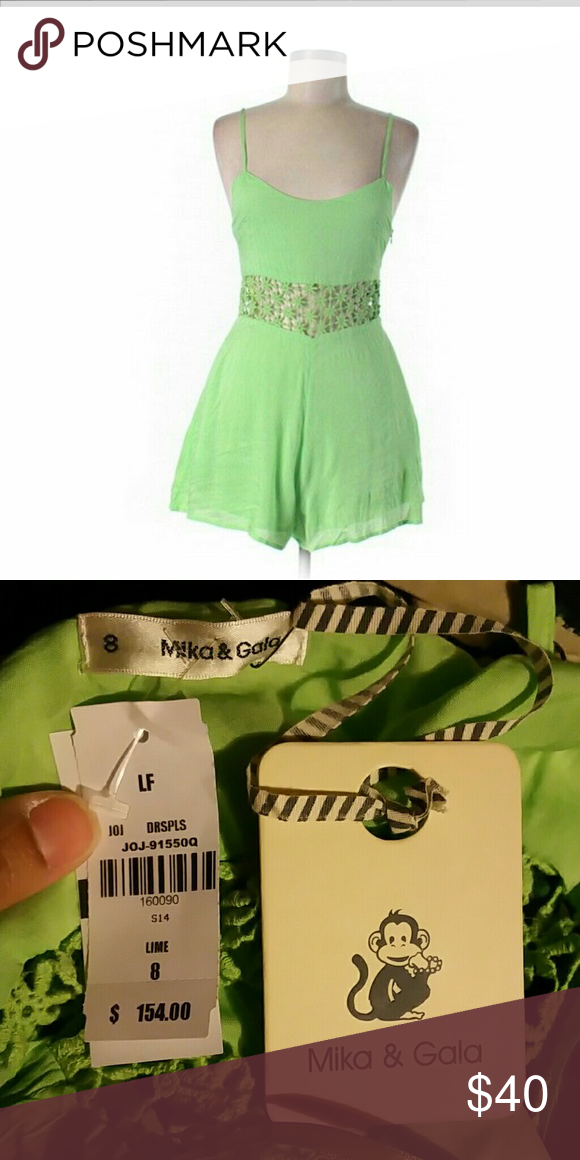 LF Mika & Gala Lime Daisy Romper Size 8 Green romper with daisy embroidered middle. Hidden side zipper, adjustable straps and hidden side pockets. Cotton and polyester content. Small spot on the inside crotch area.   NO TRADES.  NO PAYPAL. LF Pants Jumpsuits & Rompers