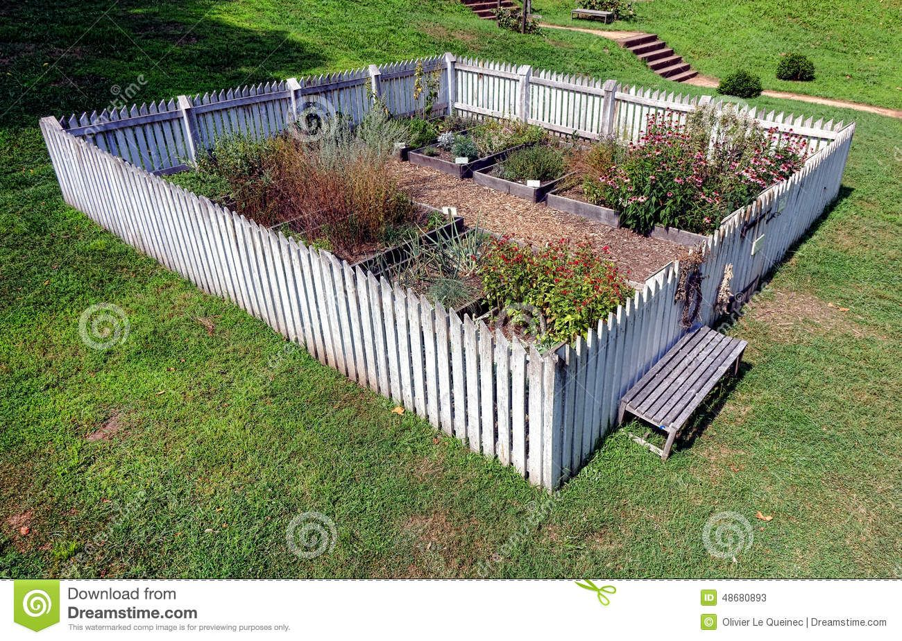Antique Colonial Garden With Old Fashioned White Picket Fence And .