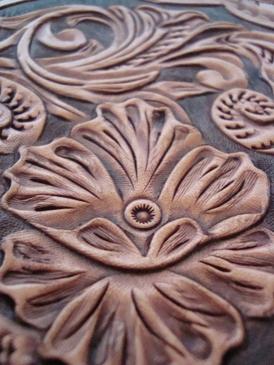 Floral carving by Bryce Hardwick of HARDWICK LEATHER