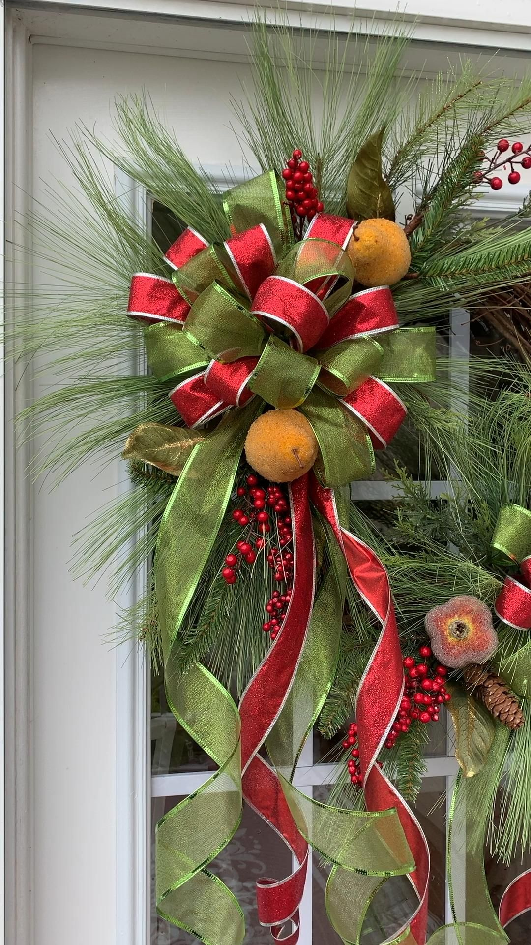 this pine Christmas wreath, has gorgeous wispy pine with Pomegranate's and Pears. This green and red Christmas wreath will look perfect on any front door. The perfect way to greet your guests this Christmas.