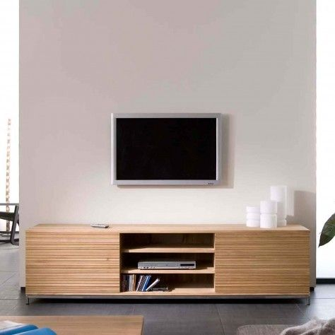 'Stone cut' TV units come in three sizes. The cuts in the oak doors provide a texture to the wood with little shadows.