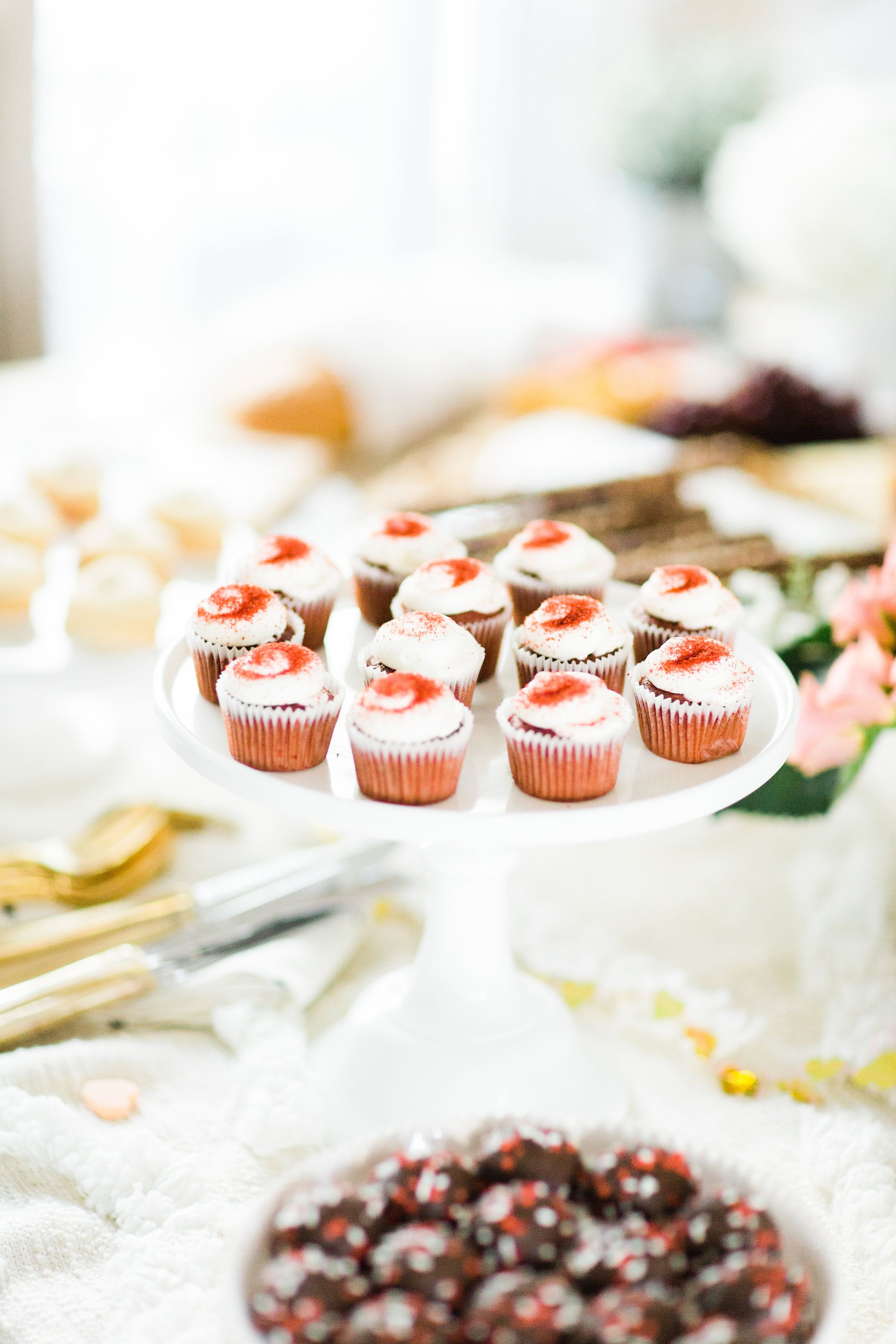 This year, celebrate Galentine's Day (and girl power) with wine and bubbly, cheese, and a whole lot of dessert. Here's how to throw one great party!   glitterinc.com   @glitterinc