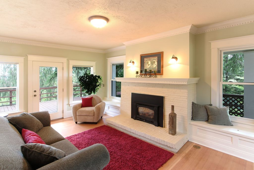 Traditional Living Room with Window seats, Painted stone ...
