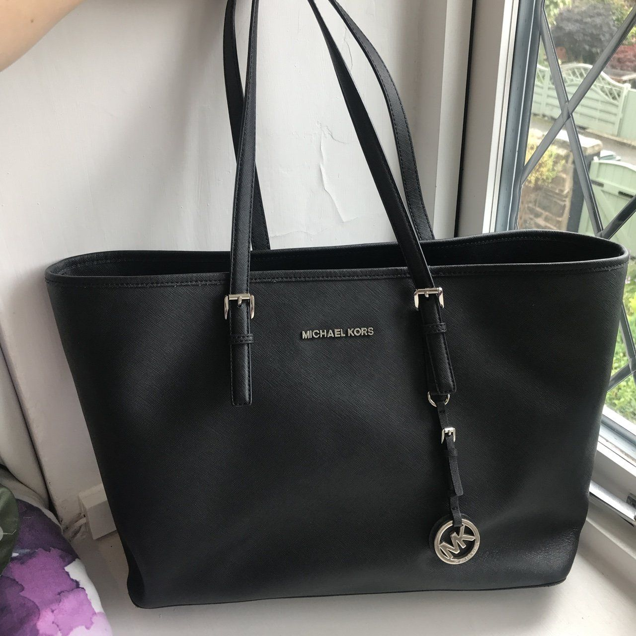 28170d06bd55 Black Michael kors jet set black bag, only defect is seen in - Depop ...