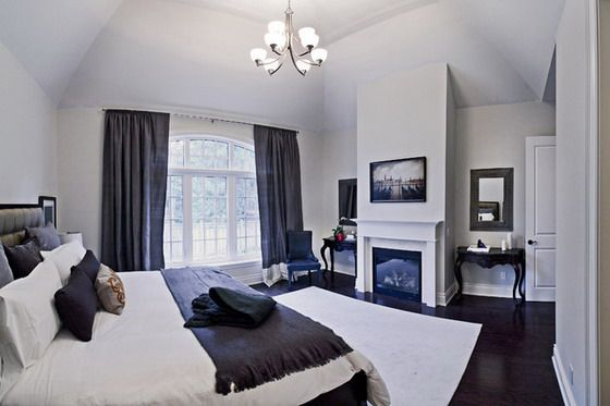 White Bedroom With Dark Blue Curtains