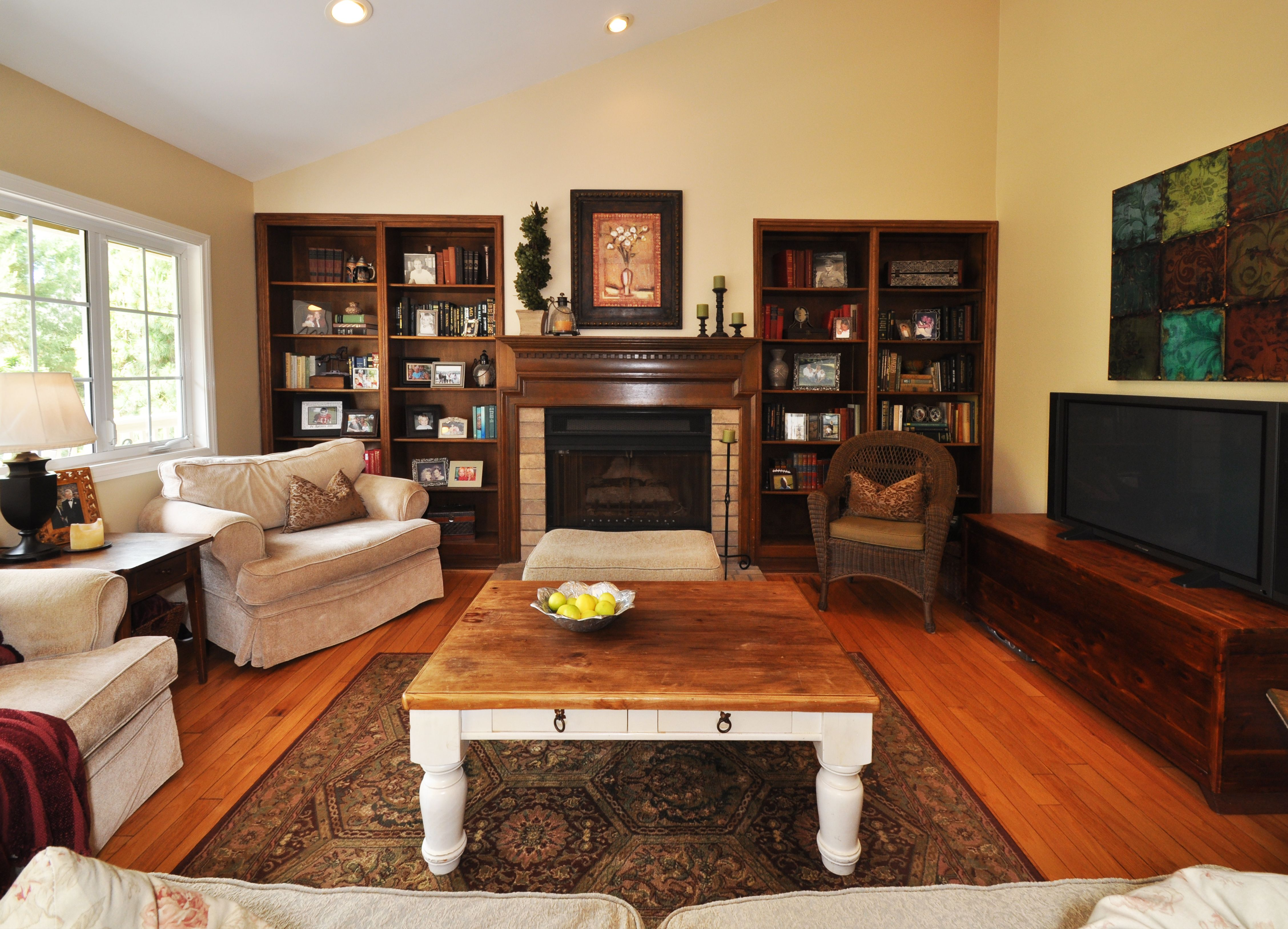Amusing Wood Coffee Table White Legs On Great Living Carpet Over Wooden Flooring And Nice White Single Fabric Sofas With Rustic Fireplace Woods Mantel And Rusti
