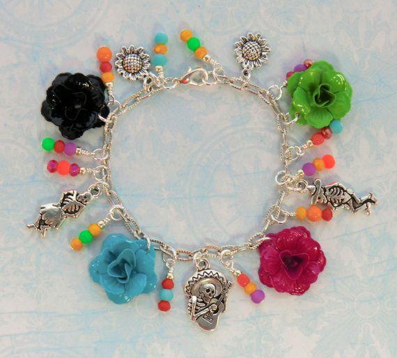 Dancing skeleton charm and bright flower bracelet by wilywolverine