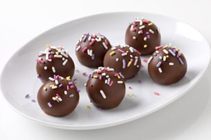 Banana Cake Balls  1/2 cup 	cold milk    1 pkg. 	(3.4 oz.) JELL-O Vanilla Flavor Instant Pudding    1 small 	fully ripe banana, mashed    1 pkg. 	(10.75 oz.) frozen pound cake, thawed, crumbled into fine crumbs    3 pkg. 	(4.4 oz. each) milk chocolate bars, chopped    2 Tbsp. 	multi-colored sprinkles    *with some editing it can be much classier and healthier